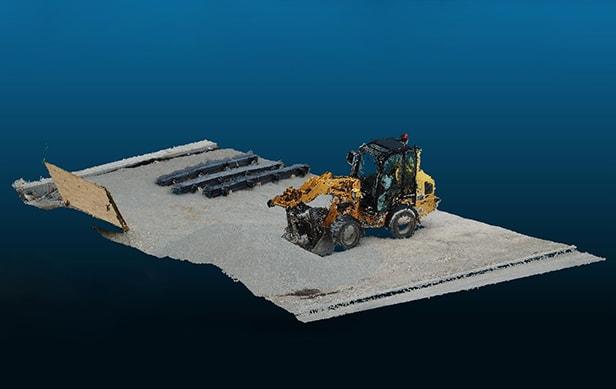 Eine 3D Punktwolke von einem Bagger und einem Teil einer Baustelle von schräg oben in einem 3D-Viewer.